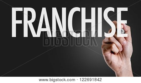 Hand writing the text: Franchise