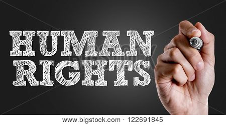 Hand writing the text: Human Rights