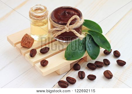 Chocolate body skin treatment, mask in jar,coffee scattered,aroma oil.