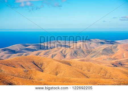 Aerial view on Fuerteventura island from Morro Velosa viewpoint with beautiful soft mointains landscape poster