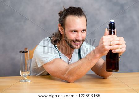Young Man Opening A Beer Bottle