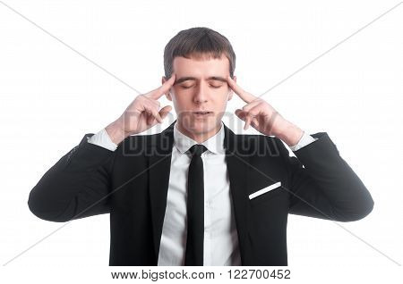 Young man in black suit and white shirt with hands near the head and his eyes closed isolated on white background