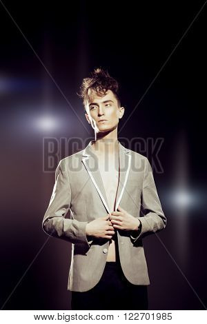 Toned photo of a fashion male model with stylish upright hair. Beauty, fashion.
