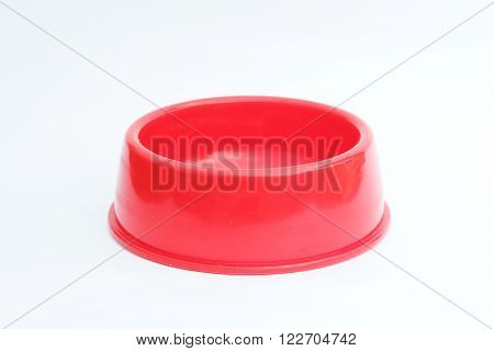 Empty red pet feeder / bowl on isolated white background