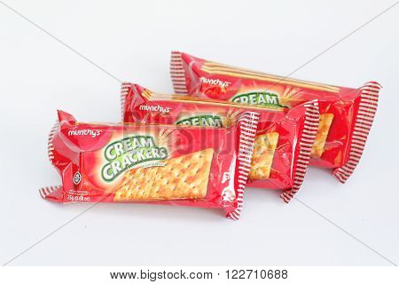 Johor,Malaysia - March 15th 2016: Mini-packs of Munchy's cream cracker on isolated on white background. Munchy's is Malaysia-based food company.