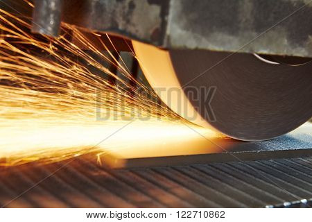 metalworking industry. finishing metal surface on horizontal grinder machine