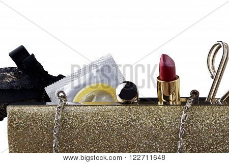 condom and lipstick in a female handbag