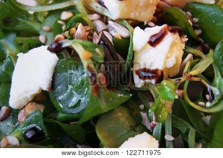 Valerianella salad with mixed seeds, parmesan shavings and balsamic vinegar. Healthy and tasty!