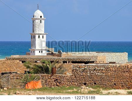 Mosque on Socotra island (Yemen) with turquoise sea background
