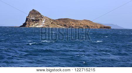 Uninhibited rocky volcanic islet  near Hanish island, Yemen poster
