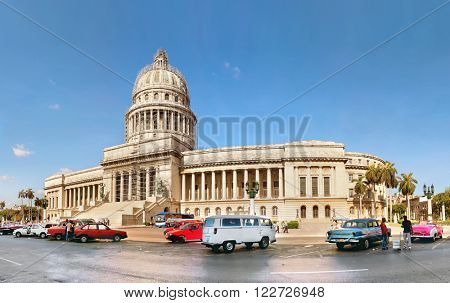 HAVANA, CUBA-MAY 14:Vintage cars near the Capitol on May 14,2013 in Havana.These old cars,the only ones that could be bought until last year,are a famous sight on the streets of the city