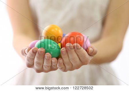 Female hands holding Easter eggs isolated on white