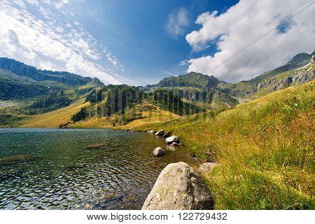 Lago di Campo (Campo lake) 1944 m. Small beautiful alpine lake in the National Park of Adamello Brenta Trentino Alto Adige Italy
