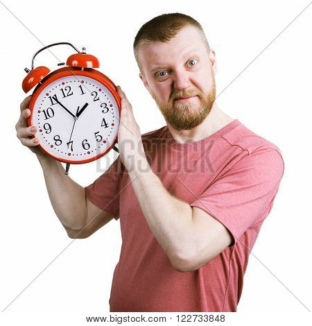 Resents bearded man with a red alarm clock