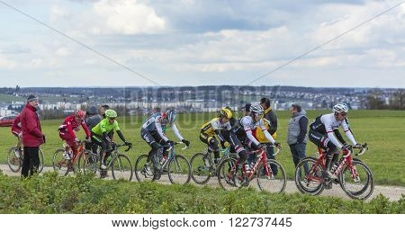 VendomeFrance- March 72016:The peloton riding on a dirty road in Vendome during the first stage of Paris-Nice 2016.