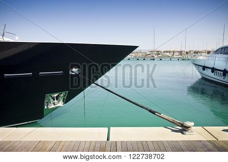 Small creek in a marina (new harbor in Pisa - Tuscany - Italy) with bow of a boat in the foreground