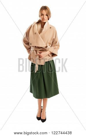 Young Woman Wearing Light Colour Coat And Green Skirt