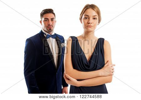 Beautiful couple wearing elegant clothes ready to go on an evening date and have a romantic dinner out