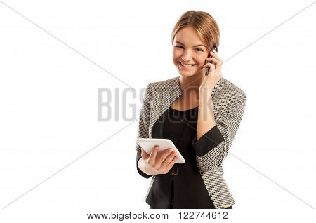 Young Business Woman Talking On The Phone And Holding Tablet