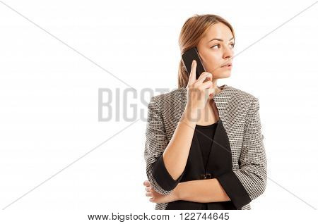 Business Woman Talking On Her Smartphone And Thinking