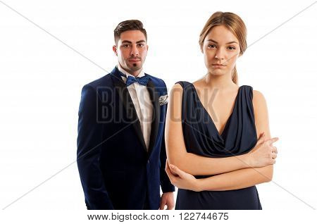Beautiful young and elegant couple dressed for a special event wearing suit bowtie and long evening dress