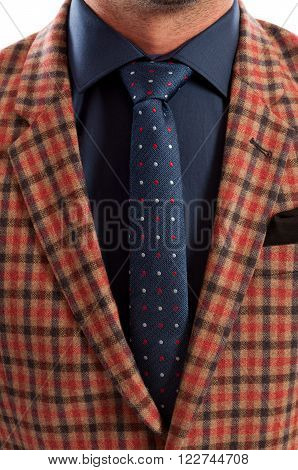 Closeup With Plaid Jacket And Dots Tie