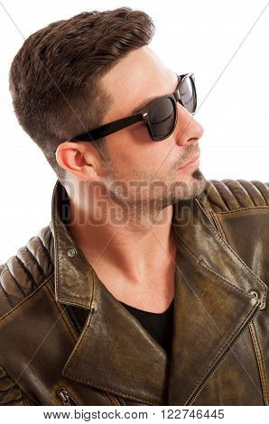 Handsome man wearing leather jacket on white background
