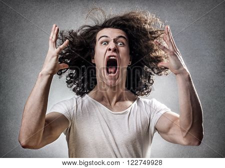 Young guy facing a mental collapse with a desperate expression
