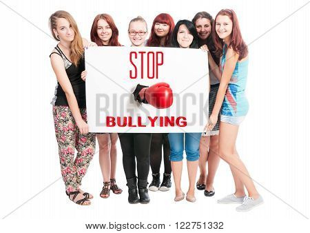 Stop Bullying concept text on white cardboard help by teen girls poster