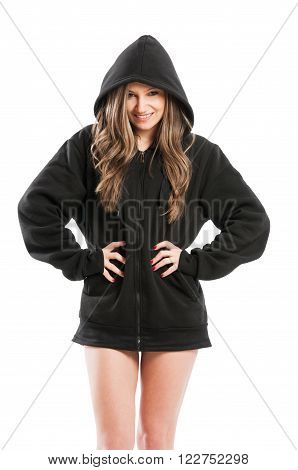 Sexy cute kinky and adorable young woman wearing a black hoodie standing isolated on white background