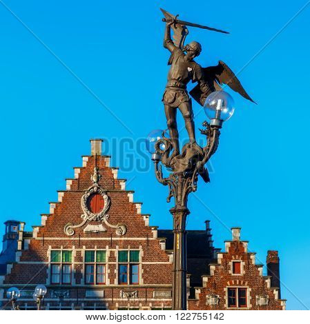 Statue of Archangel Michael, hitting with his spear the devil in the guise of a dragon on the bridge of Saint Michael in Ghent, Belgium