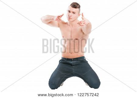 Confident Muscular Male Model On His Knees