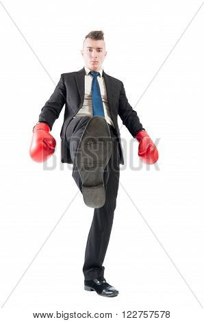 Competitive and aggresive business man tread over the competitors concept on white background