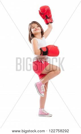 Young and cute boxer girl acting like a champion
