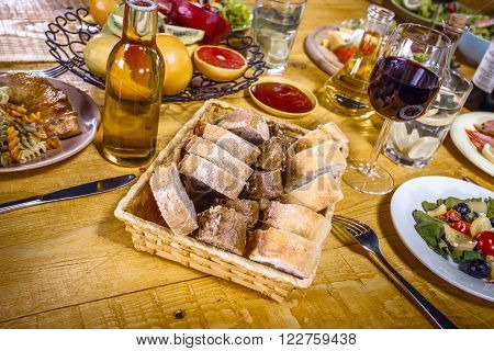 Close up creative photo of delicious meal on wooden vintage table. Focus on plate with bread