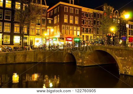 AMSTERDAM-APRIL 29: Red light district at night on April 29 2015 in Amsterdam the Netherlands. The red-light district is a part of city where prostitution is legal.