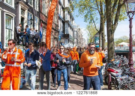 AMSTERDAM-APRIL 27: Locals and tourists celebrate King's Day in red-light district on April 272015 the Netherlands. King's Day is the largest open-air festivity in Amsterdam.