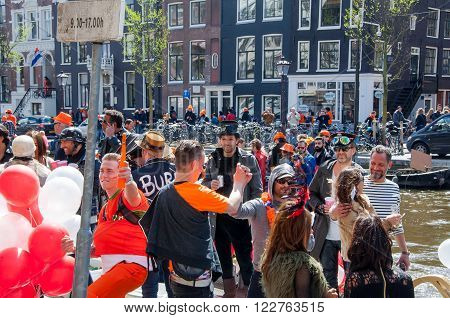 AMSTERDAM-APRIL 27: Locals and tourists have fun on a boat during King's Day the Singel canal on April 272015 the Netherlands.