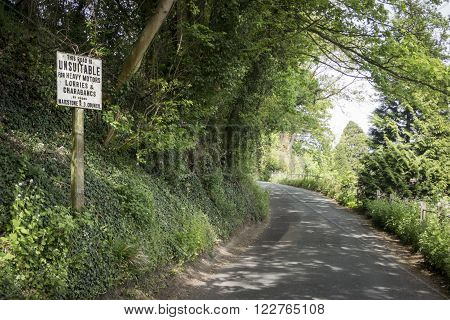 LOOSE, KENT, UK, 11 MAY 2015 - Replica of an old metal road sign warning that the road is not suitable for heavy motors lorries and charabancs