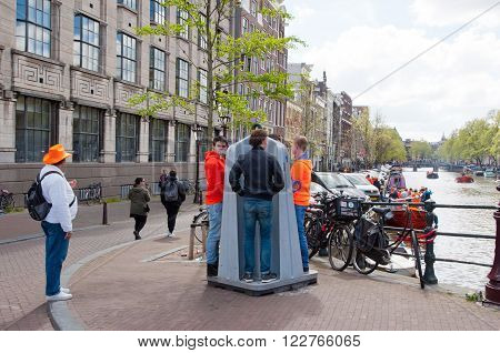 AMSTERDAMNETHERLANDS-APRIL 27: Public urinal also known as Krul on April 272015 in Amsterdam. At busy days they are installed in the necessary spots after which they are taken away and cleaned.