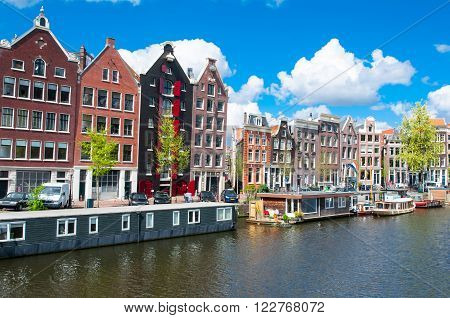 Amsterdam the Netherlands-April 27: Traditional Amsterdam cityscape with apartment houses in down town on April 272015. Amsterdam is the most populous city of the Kingdom of the Netherlands.