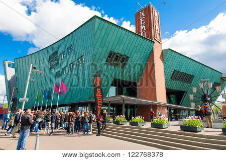 AMSTERDAM-APRIL 27: Science Center and Museum Nemo tourists are going to visit the museum on April 272015. Science Center Nemo is a science center in Amsterdam Netherlands.