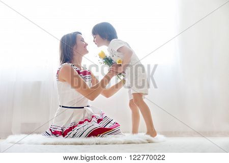 Mother And Her Child, Embracing With Tenderness And Care