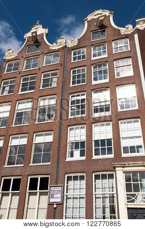 AMSTERDAM, NETHERLANDS-APRIL 27: Facade of tipical Amsterdam architecture and appartments on April 27, 2015 in Amsterdam Netherlands.