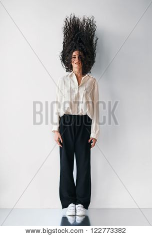 motionless fashion woman with flying hair up