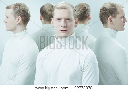 Duplicated image of mental hospital patient standing in light interior
