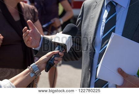 Reporter making media interview with politician or businessman