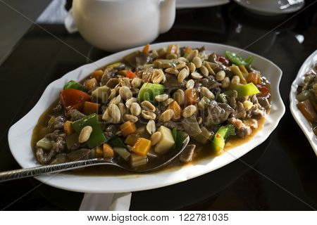 Chinese food - stir fry beef with vegetables and nuts.