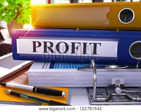 Profit - Blue Ring Binder on Office Desktop with Office Supplies and Modern Laptop. Profit Business Concept on Blurred Background. Profit - Toned Illustration. 3D Render.
