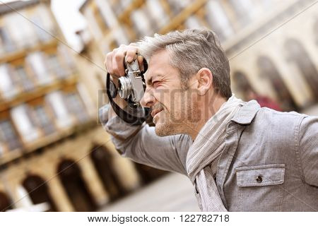 Man taking pictures on travel journey